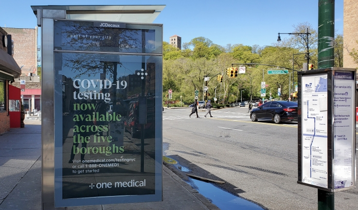 Testing advertisement on a bus shelter on Broadway, May 2020